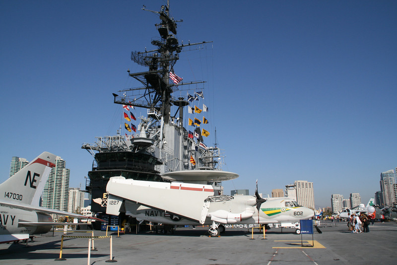 A plane with wings that fold up - on the deck of the USS Midway Museum