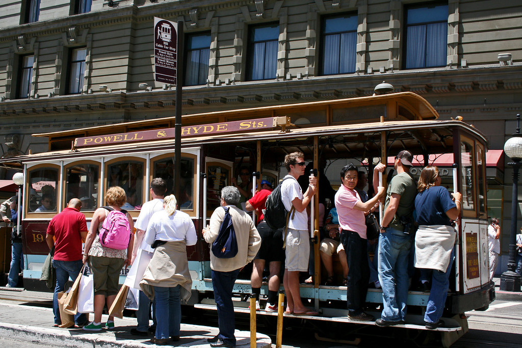Climbing on the famous San Francisco Cable Car Trolley.