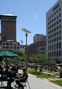 Hanging out on Union Square and enjoying the sun.  Macy's, Saks Fifth Avenue, and Tiffeny surround the square.