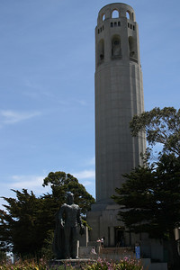 Coit Tower and a statue of Christopher Columbus.