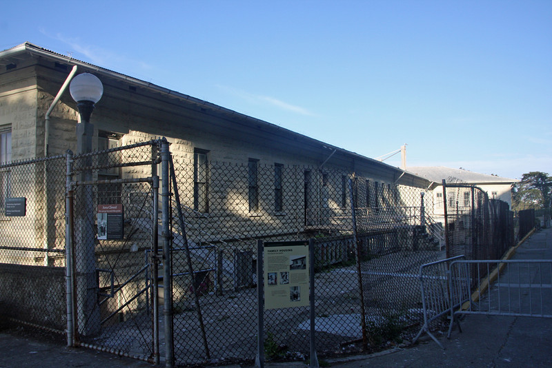 """<b>Barracks aka Building 64</b><br> <br> When Alcatraz became a Federal Penitentiary In 1933, this building was turned into """"Family Housing."""" Wives and children were restricted to the fenced residential areas on this end of the island whenever inmates were out of their cells."""
