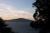 "<b>Angel Island</b> - <b>View from Alcatraz</b><br> <br> The Miwoks used Angel Island for thousands of years before the Spaniards arrived.  Ayala Cove was the staging area for the earliest water-based exploration of the bay area in 1775.   Following many years of Spanish control of the island, it  served as both a military base and the site of two government facilities (Quarantine and Immigration Stations) for nearly 100 years starting in the mid-1800s.  <br> <br> The Miwok had an animistic philosophy:  they wanted no walls and trod lightly on the land, leaving no footsteps, always apologizing to the spirits in animals or nature whenever they disturbed them in whatever fashion.  There is no evidence the Miwok had words for such concepts as war or prostitution.  Their oral history was transmitted through the stories of the elders and shamans.  Tribal boundaries were taught to children by rote.<br> <br> Only temporary houses were built on Angel Island: they did not live there permanently.  Houses were made of branches covered with mats of tule.  Each house had a small acorn house constructed on legs in order to store the acorns they would collect and protect from deer and insects.<br> <br> The Miwoks had no pottery, made no fabric, and planted no seeds.  They kept no domestic animals.  Instead, they were gatherers, fisherman, hunters, and basket makers.  <br> <br> For more detailed information about Angel Island, go <a href=""http://angelisland.org/history/"" target=""_blank""> <b>here</a></b>."