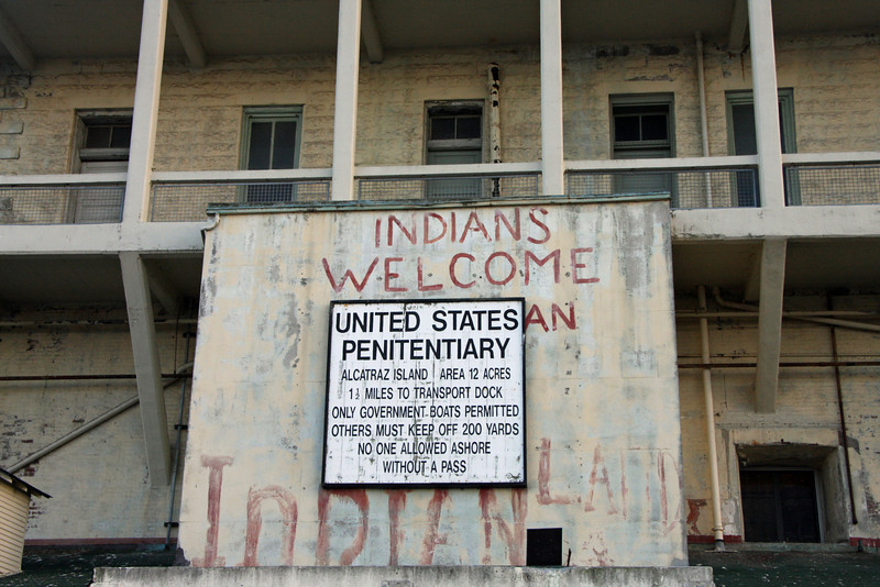 """<b>Native American Occupation</b><br> <br> Native Americans - many whose tribes were being terminated by federal policy - occupied Alcatraz  in 1964. In 1969, they attempted to reclaim the land saying that an 1868 federal treaty allowed Native Americans to use all federal territory that the government wasn't actively using.  After almost two years of occupation, the government forced them off.  Their 18-month occupation would cause a great change in federal policy towards American Indians that would save the tribes.<br> <br> The story of the occupation is covered in the Alcatraz Museum, and graffiti remains claiming """"this is Native American land.""""<br> <br> Every year, thousands of American Indians return to Alcatraz Island to honor the veterans of the 1969 occupation by Indians of All Tribes and to continue their political struggle for self determination.<br> <br> Additional information can be found at <a href=""""http://www.nps.gov/alca/historyculture/we-hold-the-rock.htm"""" target=""""_blank""""> <b>The Alcatraz Indian Occupation</a></b>."""
