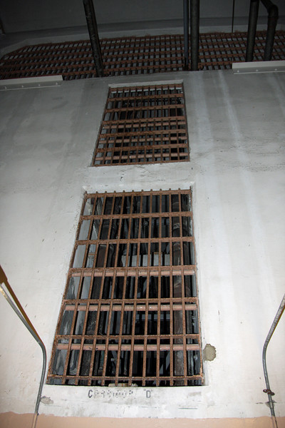 "<b>Section of Prison where Marines lowered Grenades</b><br> <br> In this section, I'm standing on the shrapnel scars shown in the previous photo.  Above, there is a hole that was chopped in the roof so that Marines could lower grenades, which were tied to cords, during the 1946 ""Battle of Alcatraz."""