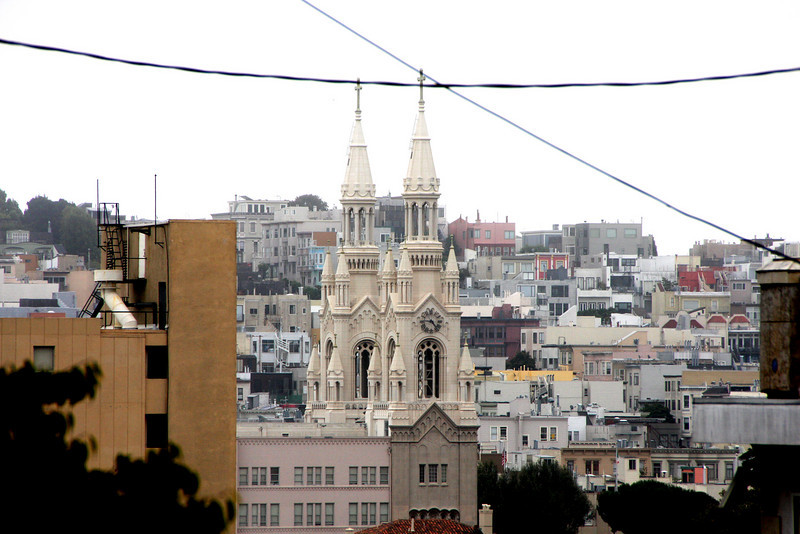 """<b>Sts. Peter and Paul Church</b><br> <br> Sts. Peter and Paul Church, completed in 1924,  is a Roman Catholic Church in San Francisco's North Beach neighborhood. It is administered by the Salesians of Don Bosco. It is known as """"La cattedrale d'Italia ovest,"""" or """"The Italian Cathedral of the West."""" This building is very unusual in that the parish school is situated atop the church itself, around its clerestory level and is accessible from stairways under each of its twin towers."""