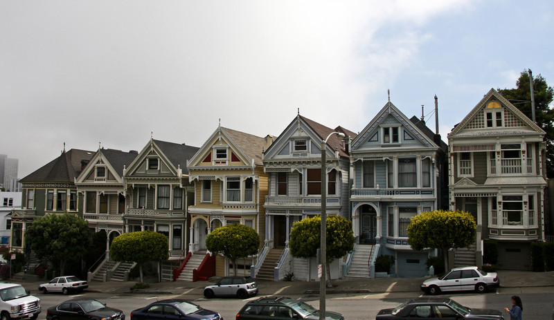 """<b>Painted Ladies</b> is a term used for Victorian and Edwardian houses and buildings painted in three or more colors that embellish or enhance their architectural details. The term was first used for San Francisco Victorian houses by writers Elizabeth Pomada and Michael Larsen in their 1978 book <i>Painted Ladies - San Francisco's Resplendent Victorians</i>.<br> <br> In 1963, San Francisco artist Butch Kardum began combining intense blues and greens on the exterior of his Italianate-style Victorian House. His house was criticized by some, but other neighbors began to copy the bright colors on their own houses. Kardum became a color designer, and he and other artists such as Tony Cataletich, Bob Buckter, and Jazon Wonders began to transform dozens of gray houses into Painted Ladies. By the 1970s, the colorist movement, as it was called, had changed entire streets and neighborhoods. This process continues to this day.<br> <br> About 48,000 houses in the Victorian and Edwardian styles were built in San Francisco between 1849 and 1915 (with the change from Victorian to Edwardian occurring on the death of Queen Victoria in 1901), and many were painted in bright colors. As one newspaper critic noted in 1885, """"...red, yellow, chocolate, orange, everything that is loud is in fashion...if the upper stories are not of red or blue... they are painted up into uncouth panels of yellow and brown...""""<br> <br> One of the best-known groups of """"Painted Ladies"""" is the row of Victorian houses at 712–720 Steiner Street, bordering Alamo Square park, in San Francisco. It is sometimes known as """"Postcard Row."""" The houses were built between 1892 and 1896 by developer Matthew Kavanaugh, who lived next door in the 1892 mansion at 722 Steiner Street (the Shannon-Kavanaugh House shown in previous photos)."""