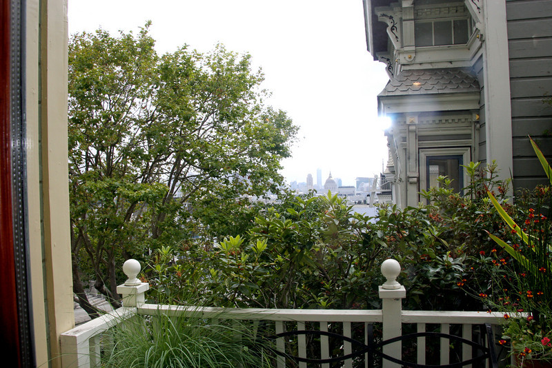 "<b>Shannon-Kavanaugh Home</b> - <b>Patio off the Dining Room</b><br> <br> Amid the famous Alamo Square, the <b>Shannon-Kavanaugh House</b> is one of the ""7 Sisters"" in Alamo Square Park. ""Postcard Row"" and ""Painted ladies"" are other common names.<br> <br> The Shannon-Kavanaugh House, built in 1892 by carpenter-builder Matthew Kavanaugh for his own family, has become one of the most famous buildings in America. The house contains 4500 square feet on four floors, set against the magnificent backdrop of the San Francisco city skyline.<br> <br> The interior features, such as the gilded mirror in the main parlor and the working gaslights on the main floor, were salvaged from other prominent San Francisco homes. The elegant Queen Anne-style structure has become familiar through its role in over 40 films, television series and commercials. The Shannon-Kavanaugh home is mostly remembered for the TV Show, ""Full House.""<br> <br> This house is not opened to the general public; however, we were fortunate enough to have chosen the tour company that is invited inside this gorgeous home.  Our 25-minute house tour was guided by the current owner of the home, Michael Shannon.  [B]"