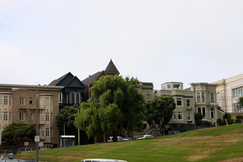 """<b>Alamo Square</b> is a residential neighborhood and park.  It consists of four city blocks at the top of a hill overlooking much of San Francisco, with a number of large and architecturally distinctive mansions along the perimeter.<br> <br> A row of Victorian houses facing the park on Steiner Street, known as the """"Painted Ladies,"""" are often shown in the foreground of panoramic pictures of the city's downtown area. On a clear day, the Transamerica Pyramid building and the tops of the Golden Gate Bridge and Bay Bridge can be seen from the park's center."""