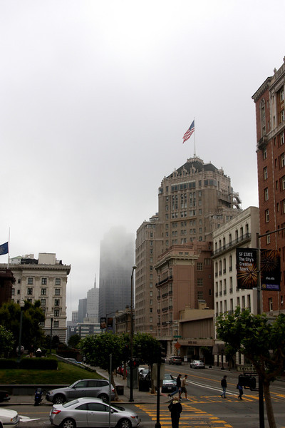 <b>Mark Hopkins Hotel - Official name is the InterContinental Mark Hopkins San Francisco</b> [building with the American Flag]<br> <br> The Mark Hopkins Hotel is a 19-story luxury hotel located at Number One Nob Hill and 999 California Street. Mark Hopkins, one of the founders of the Central Pacific Railroad, chose the southeastern peak of Nob Hill as the site for a dream home for his wife, Mary. The mansion was completed in 1878, after his death.<br> <br> On her death at the age of seventy-three in 1891, Mrs. Mary Sherwood Hopkins left the Nob Hill mansion and a $70-million estate to her second husband, Edward Francis Searles. In 1893, Searles donated the building and grounds to the San Francisco Art Association (now San Francisco Art Institute), for use as a school and museum.<br> <br> The Mark Hopkins mansion survived the 1906 San Francisco earthquake, however, it was destroyed in the three-day fire that followed the earthquake. Mining engineer and hotel investor George D. Smith purchased the Nob Hill site, removed the Art Association building, and began construction of a luxury hotel.  [B]