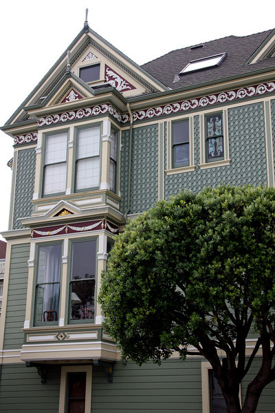 """Amid the famous Alamo Square, the <b>Shannon-Kavanaugh House</b> is one of the """"7 Sisters"""" in Alamo Square Park. """"Postcard Row"""" and """"Painted ladies"""" are other common names.<br> <br> The Shannon-Kavanaugh House, built in 1892 by carpenter-builder Matthew Kavanaugh for his own family, has become one of the most famous buildings in America. The house contains 4500 square feet on four floors, set against the magnificent backdrop of the San Francisco city skyline.<br> <br> The interior features, such as the gilded mirror in the main parlor and the working gaslights on the main floor, were salvaged from other prominent San Francisco homes. The elegant Queen Anne-style structure has become familiar through its role in over 40 films, television series and commercials. The Shannon-Kavanaugh home is mostly remembered for the TV Show, """"Full House.""""<br> <br> This house is not opened to the general public; however, we were fortunate enough to have chosen the tour company that is invited inside this gorgeous home.  Our 25-minute house tour was guided by the current owner of the home, Michael Shannon."""