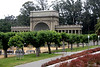 "<b>Music Concourse in Golden Gate Park</b> is a sunken, oval-shaped open-air plaza originally excavated for the California Midwinter International Exposition of 1894. Its focal point is the Spreckels Temple of Music, also called the ""Bandshell"" where numerous music performance have been staged. It includes a number of statues of various historic figures, four fountains, and a regular grid array of heavily pollarded trees."