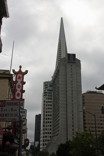 <b>Transamerica Pyramid</b><br> <br> This view of the Transamerica Pyramid is from one of the streets in Chinatown.  It is the tallest and most recognizable skyscraper in the San Francisco skyline. Although the building no longer houses the headquarters of the Transamerica Corporation, it is still strongly associated with the company and is depicted in the company's logo. Designed by architect William Pereira, at a height of 260 m (853 feet), upon completion in 1972, it was among the five tallest buildings in the world.