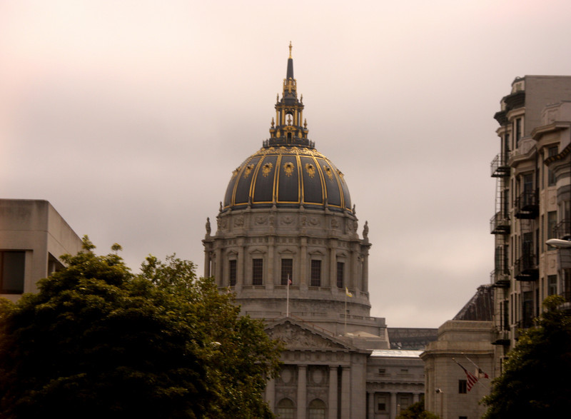 "<b>City Hall</b> of San Francisco opened in 1915. It is a Beaux-Arts monument to the brief ""City Beautiful"" movement that epitomized the high-minded American Renaissance of the period 1880–1917. <br> <br> The structure's dome is the fifth largest in the world. The present building is actually a replacement for an earlier City Hall that was completely destroyed during the 1906 Earthquake. The Loma Prieta earthquake of 1989 damaged the structure and twisted the dome four inches (102 mm) on its base. Located on Van Ness Avenue, in the heart of San Francisco, the new City Hall was re-opened in January 1999.  [B]"