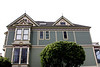 "Amid the famous Alamo Square, the <b>Shannon-Kavanaugh House</b> is one of the ""7 Sisters"" in Alamo Square Park. ""Postcard Row"" and ""Painted ladies"" are other common names.<br> <br> The Shannon-Kavanaugh House, built in 1892 by carpenter-builder Matthew Kavanaugh for his own family, has become one of the most famous buildings in America. The house contains 4500 square feet on four floors, set against the magnificent backdrop of the San Francisco city skyline.<br> <br> The interior features, such as the gilded mirror in the main parlor and the working gaslights on the main floor, were salvaged from other prominent San Francisco homes. The elegant Queen Anne-style structure has become familiar through its role in over 40 films, television series and commercials. The Shannon-Kavanaugh home is mostly remembered for the TV Show, ""Full House.""<br> <br> This house is not opened to the general public; however, we were fortunate enough to have chosen the tour company that is invited inside this gorgeous home.  Our 25-minute house tour was guided by the current owner of the home, Michael Shannon."