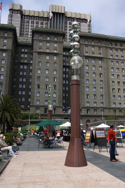 "<b>Union Square</b> was built and dedicated by San Francisco's first American mayor John Geary in 1850 and is so named for the pro-Union rallies that happened there before and during the United States Civil War. <br> <br> Since then, the plaza underwent many notable changes with the most significant first happening in 1903 with the dedication of a 97-foot-tall (30 m) monument to Admiral George Dewey's victory at the Battle of Manila Bay during the Spanish American War. It also commemorates U.S. President William McKinley, who had been recently assassinated.<br><br>The second major significant change happened between 1939-1941 when a large underground parking garage was built under the square that relocated the plaza's lawns, shrubs and the Dewey monument to the garage ""roof."" It was the world's first underground parking garage and was designed by Timothy Pflueger.  [B]"