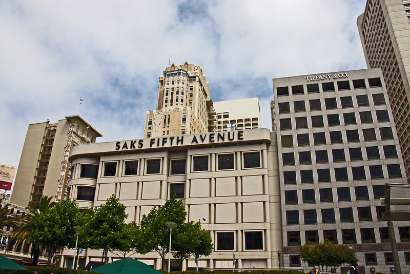 """<b>Union Square</b> was built and dedicated by San Francisco's first American mayor John Geary in 1850 and is so named for the pro-Union rallies that happened there before and during the United States Civil War. <br> <br> Since then, the plaza underwent many notable changes with the most significant first happening in 1903 with the dedication of a 97-foot-tall (30 m) monument to Admiral George Dewey's victory at the Battle of Manila Bay during the Spanish American War. It also commemorates U.S. President William McKinley, who had been recently assassinated.<br><br>The second major significant change happened between 1939-1941 when a large underground parking garage was built under the square that relocated the plaza's lawns, shrubs and the Dewey monument to the garage """"roof."""" It was the world's first underground parking garage and was designed by Timothy Pflueger. [B]"""