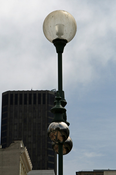 """<b>Union Square</b> was built and dedicated by San Francisco's first American mayor John Geary in 1850 and is so named for the pro-Union rallies that happened there before and during the United States Civil War. <br> <br> Since then, the plaza underwent many notable changes with the most significant first happening in 1903 with the dedication of a 97-foot-tall (30 m) monument to Admiral George Dewey's victory at the Battle of Manila Bay during the Spanish American War. It also commemorates U.S. President William McKinley, who had been recently assassinated.<br><br>The second major significant change happened between 1939-1941 when a large underground parking garage was built under the square that relocated the plaza's lawns, shrubs and the Dewey monument to the garage """"roof."""" It was the world's first underground parking garage and was designed by Timothy Pflueger."""