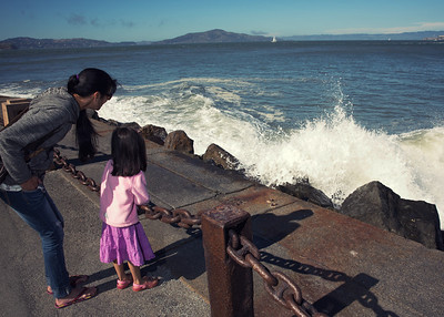 Waves breaking on Fort Point seawall