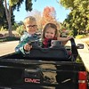Burke giving Karis a ride in the new Bollman mini electric pickup