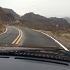 Navigating uphill in the rain on the old Rt 66 to Oatman, AZ.  An exciting one lane road with two yellow lines down the middle.