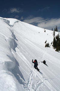 Ski poles are used extensively as anchor to avoid sliding.