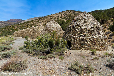 View of the most well preserved charcoal kilns in the west, located in Wildrose Canyon at Death Valley National Park, California.  These kilns were built in 1877 and used to burn pine wood to make charcoal.  This charcoal was then used in the smelters to melt silver and lead from the nearby mines.