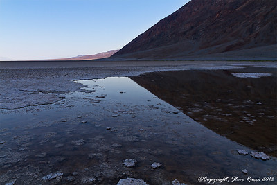 Spring fed pool of water at Badwater Basin in Death Valley National Park - California.  This is known was Badwater because the water pushes up through all of the salt making it undrinkable.  It's interesting to see standing water in one of the hottest places on Earth.
