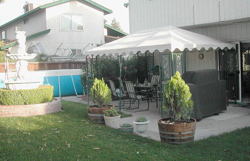 Back yard, Manteca, with patio, pool and fountain