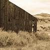 an abandon barn ponders the hills in Soledad, CA