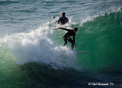 Surfers at Huntington Beach, CA December 21, 2011