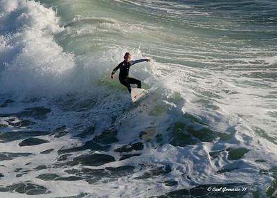 Surfer at Huntington Beach, CA December 28, 2011