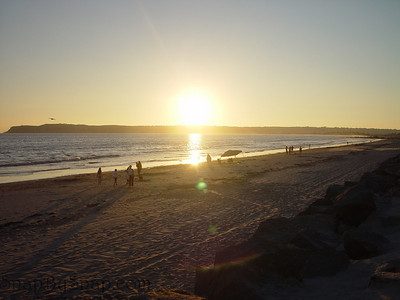 Beach goers enjoys the sunset on Coronado Island.