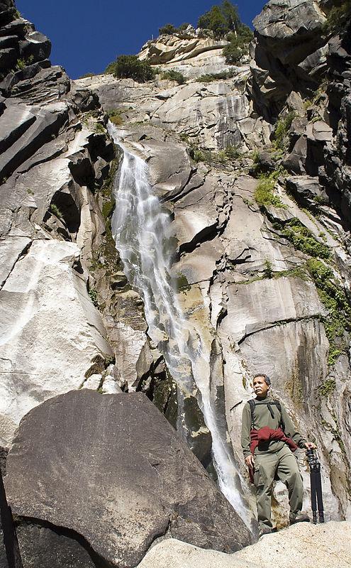 Munir in front of the 240 feet high Cascade Creek falls.