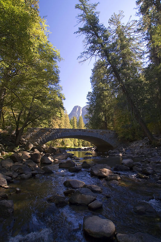 The Valley Loop Trail crosses the Merced River at Pohono bridge.
