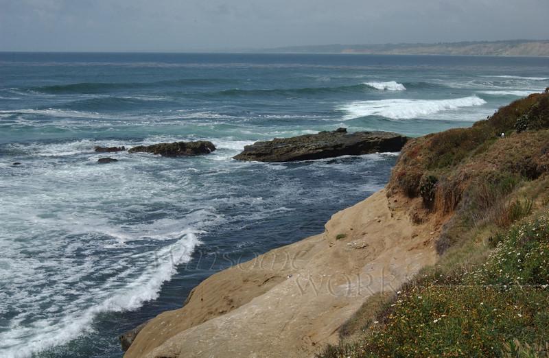 La Jolla scene showing the coastline many miles North as well