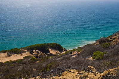 On the eastern side (looking to Santa Barbara)  of the point is Little Dume, known as a great surf spot, Windward Beach, and Zuma   Point Dume, Malibu, California