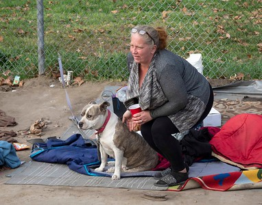 Homeless lady makes sure her best friend has enough to eat.