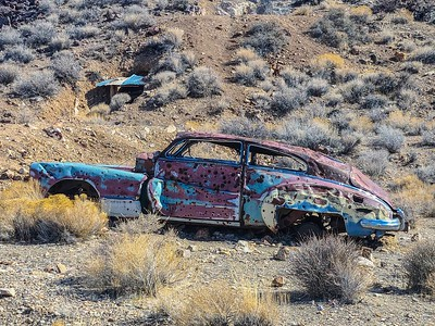 Abandoned vehicles were used for target practice.