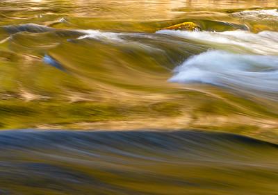 Merced River rushing thru the valley