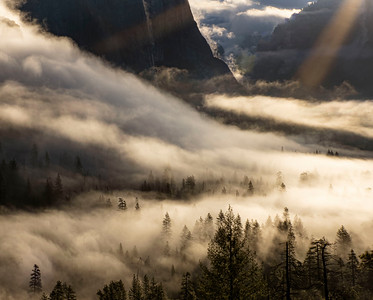 A ray of hope in the swirling clouds on the valley floor