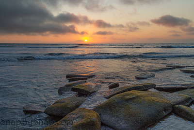 A sunset from a rocky shore