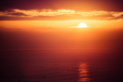 The Rising Sun over the Ocean