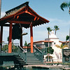 "Bell of Friendship - Shelter Island - San Diego, CA  3-30-96<br /> The citizens of Yokohama, Japan presented the Friendship Bell to San Diego in May 1958 as part of the Centennial Celebration of formal relations between that country and the United States. It also served to mark the establishment of the sister city relationship between San Diego and Yokohama, which is the first such affiliation on the West Coast.  The bell itself stands 6-feet high and weighs in at almost two and one-half tons. The words ""Bell of Friendship"" are inscribed on it in both English and Japanese. Like other traditional Japanese bells, the Friendship Bell has no clapper inside. It is rung instead by being struck with a large wooden ram that is suspended horizontally from two v-shaped chains in the bell house. To ring the bell, the ram is pulled back with a lanyard and then released, which causes it to strike a specially raised surface on the bell. The bell house is typical of those found in Japan. It is open on four sides and surrounded by a moat."