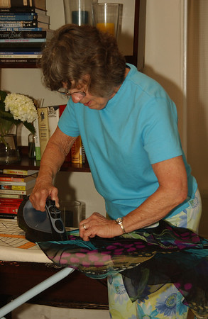 Mom ironing away... OH! That's my dress she's ironing. It's good I helped her by taking a photo.  :o)
