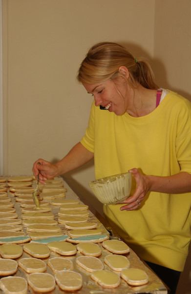 Still at work, late into the night (multi-tasking on a phone call & icing cookies)