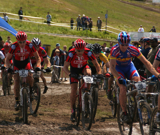 Men's short track mountain bike competition. Check how clean their jerseys are.