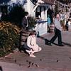Donna Feeding Birds in Seaport Village, San Diego, CA - 1/28/86