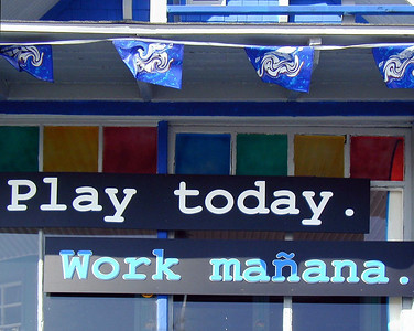 Play today. Work manana.  Motto on shop of the Venice Beach Boardwalk  Venice Beach, California, 2000