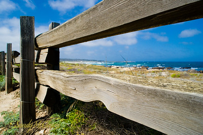 A fence along the 17-Mile Drive that goes through and around the Pebble Beach Golf Course.