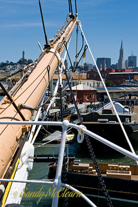 Standing on the bow of the Balclutha, and looking towards the Transamerica Building and Coit Tower in downtown San Francisco.